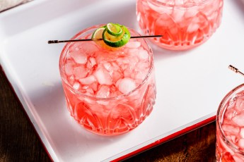 Header image of glasses of cherry limeade on a red and white enamelware tray.