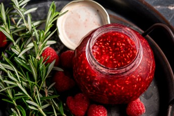 A header shot of rosemary, raspberries, and raspberry rosemary jam.