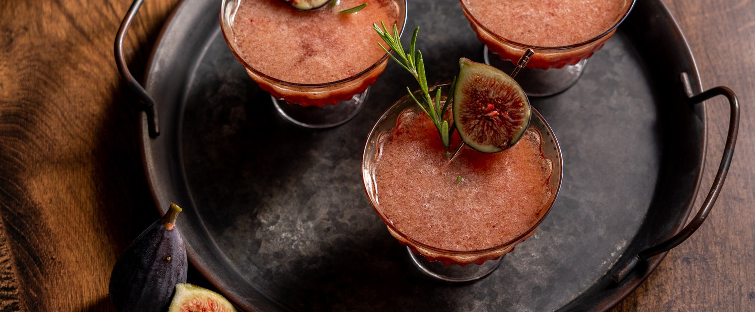 A header shot of some fig and rosemary gin smash cocktails.