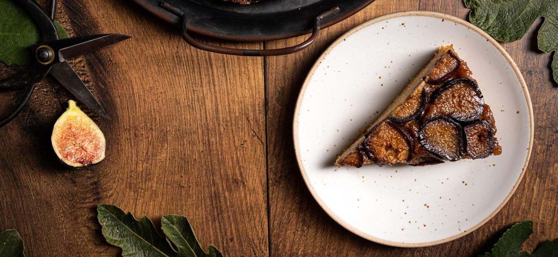 Header shot of a slice of fig and caramel upside down cake.