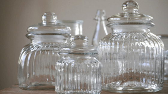 Use attractive containers for under-the-sink organization so you'll want to keep the space tidy.
