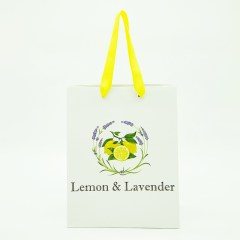 150g white cardboard material with a matte lamination and premium yellow ribbon handles