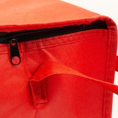 100g non-woven material with added insulation. The top flap has a full coverage zipper closure  with printing on all sides. As shown in the picture above, there are two handle straps available – one stemming from the middle, or two from the front and back sides. This bag is used at a high-end grocery/deli.