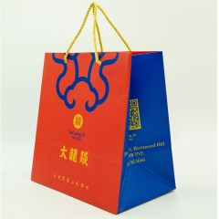 210g mattle laminated white cardboard bag with gold detailing, vibrant full colour print and rope handle