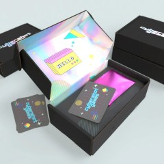 matte black mailer box (300g cardboard) with a holographic interior design