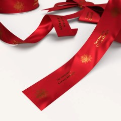 bright red ribbon with a simple seasonal greeting in fold foil print