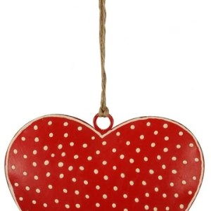 A red metal heart with white polka dots and a jute hanger