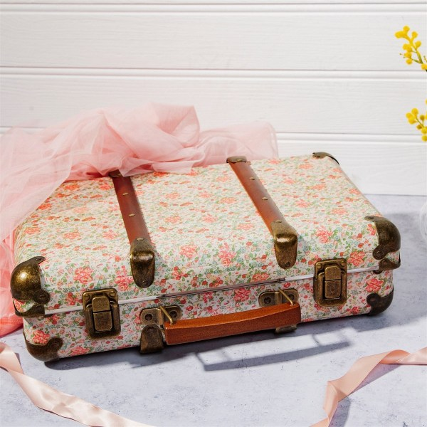 A floral handheld suitcase with brown leather straps