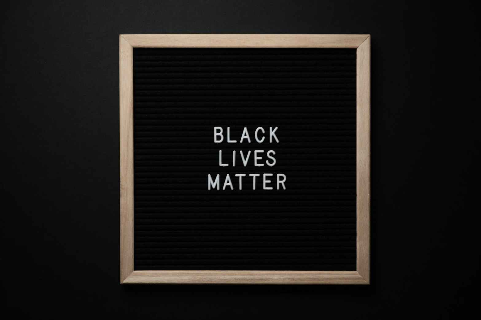 slogan black lives matter on black board