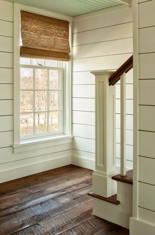 Wood planked shiplap walls to add character to a new house