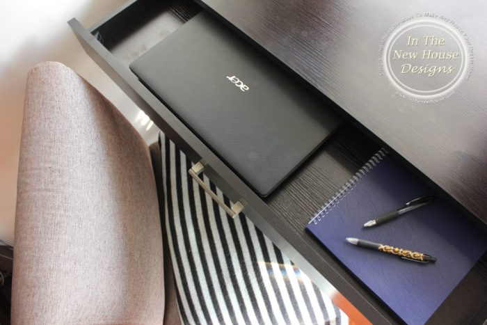 Store laptop inside desk drawer to keep it out of sight