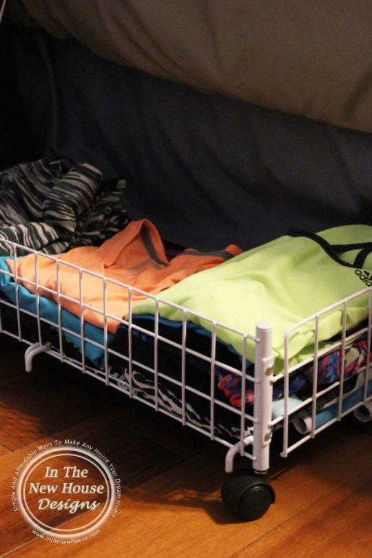 Utilize the space under your bed by keeping clothes in small rolling baskets