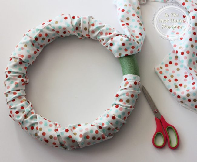 Wrap fabric around foam wreath