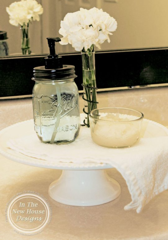 Create a bathroom pedestal with a cake stand to show off soaps and bath salts