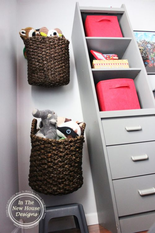 Store stuffed animals in baskets hung on the wall with heavy duty hooks