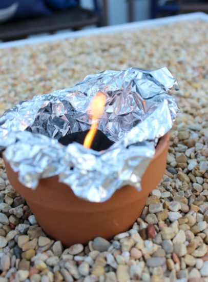 Charcoal in a terra cotta pot for individual smores roasting stations