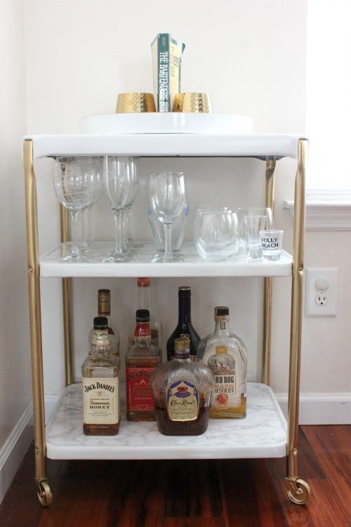 rolling bar cart to store barware in small spaces