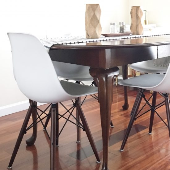 modern eames chairs with vintage table