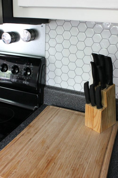 kitchen wood cutting board and knife block