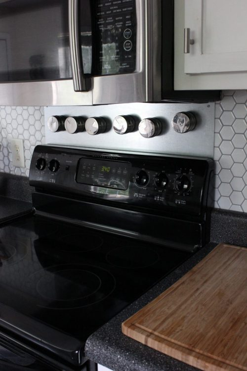 Magnetic spice jars over stove