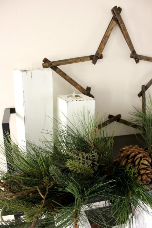 rustic christmas candle pillars and greenery