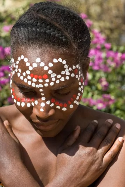 Young African girl, tribal painted face in white and red
