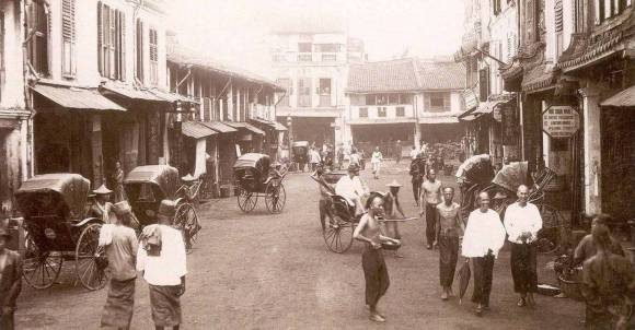 An old photograph of Singaporean shophouses, taken prior to WWII (rickshaws were banned in Singapore in 1945, after the liberation, due to health-and-safety concerns).
