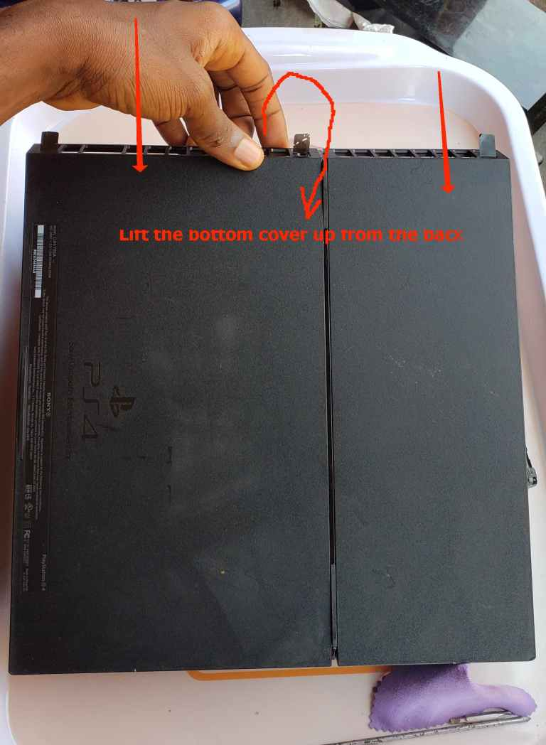safely ope the ps4 bottom cover