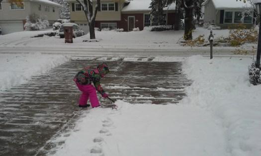 Emmy shoveling snow