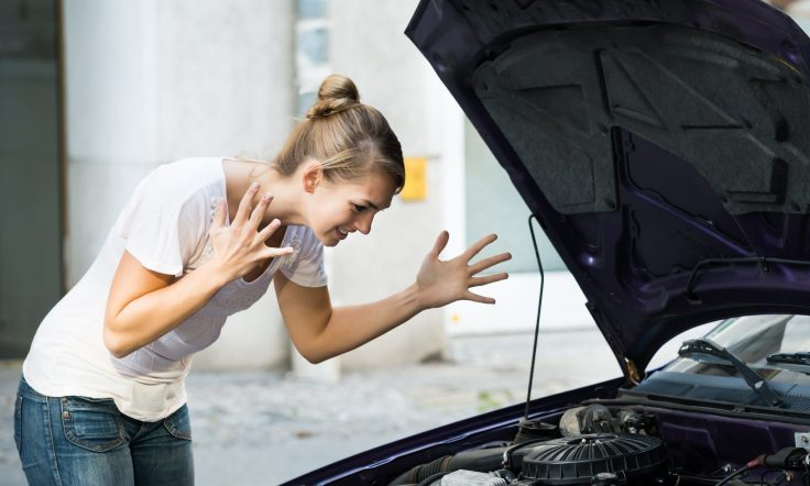 cropped-woman-with-engine-problem.jpg