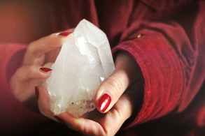 close up photo of person holding crystal stone