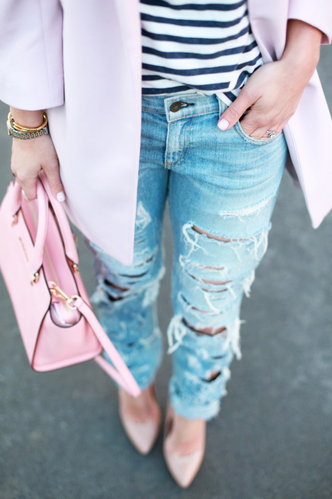 Pink purse and ripped jeans