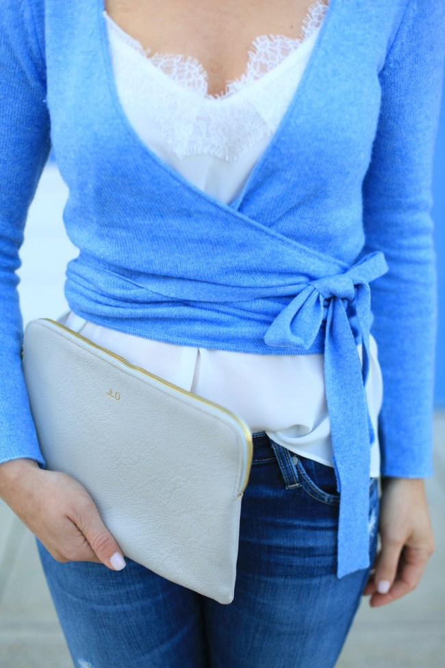 J.Mclaughlin blue wrap sweater worn over a white lace cami