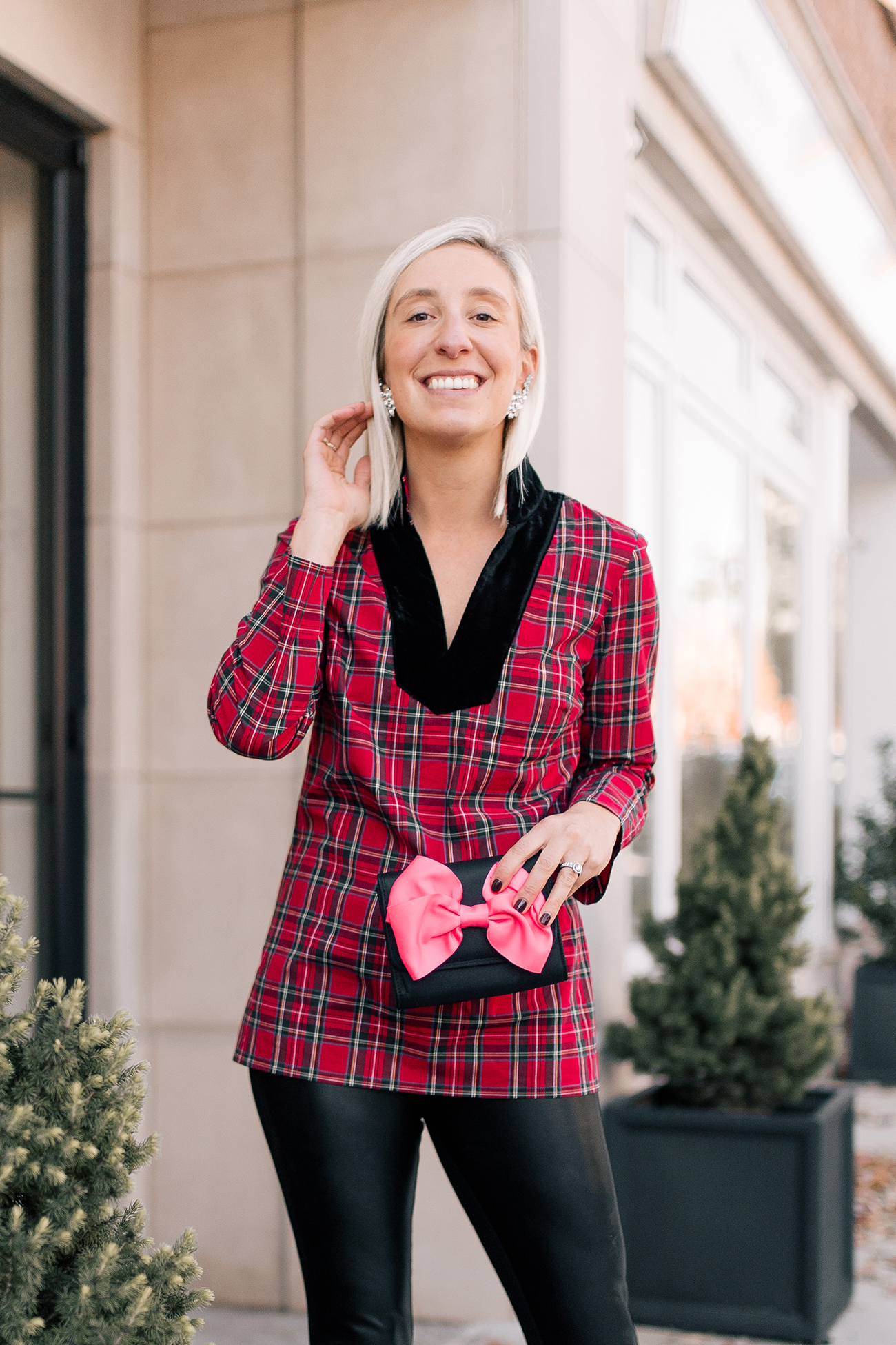 9bd73ce3e4d7 I love these plaid jeans for a casual holiday cocktail hour. Pair them with  a cashmere sweater and sparkly earrings to dress them up.