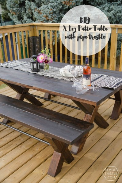 diy outdoor patio table DIY X Leg Patio Table with Pipe Trestle - Lemon Thistle
