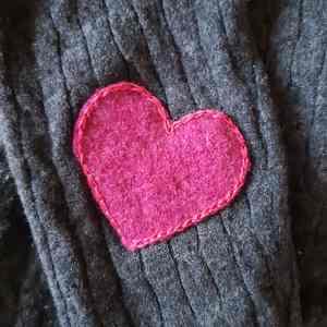 réparation pull laine coeur
