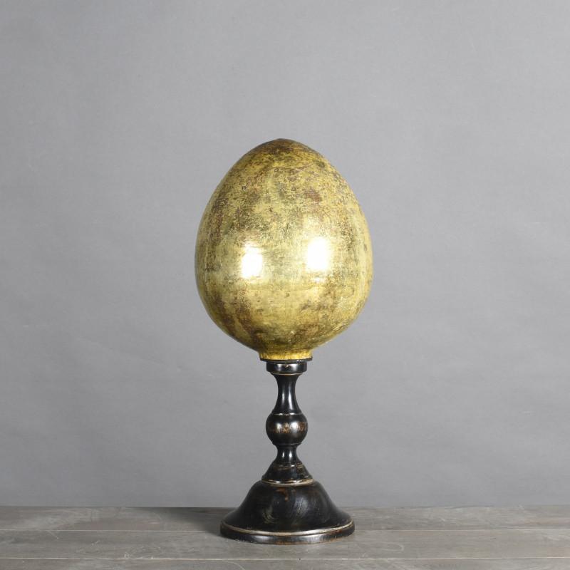 uovo oro piedistallo