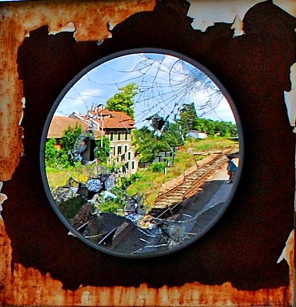 Broken mirror at railway station, France