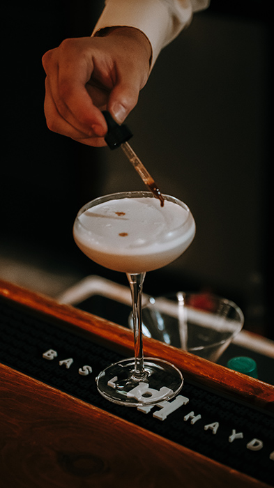 close up of a cocktail being mixed