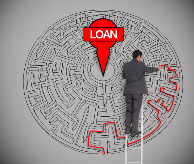 Businessman trying to find a loan in a maze