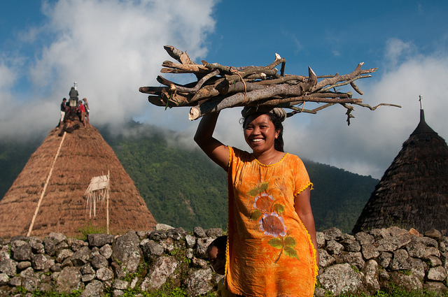 woman-carrying-firewood