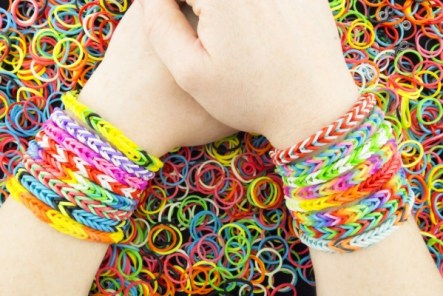 http://www.dreamstime.com/royalty-free-stock-images-rubber-bands-bracelets-teen-showing-her-arms-image39612309