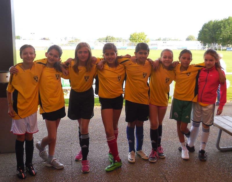 Sama with her football team in Geneva