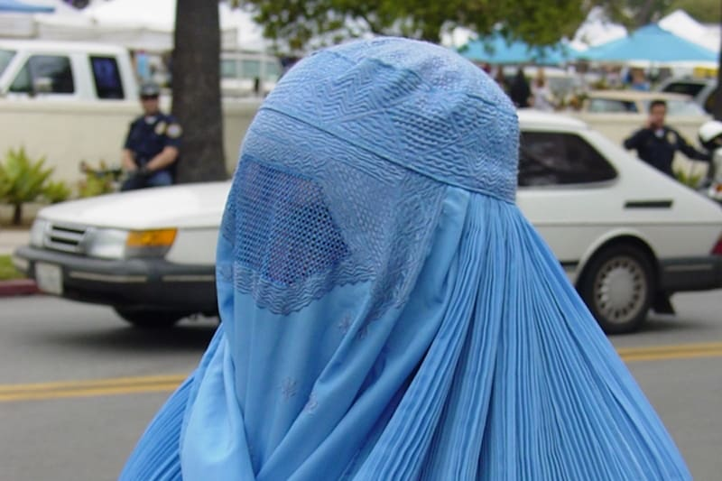 A woman wearing a burka - © Brent Hatcher | Dreamstime.com