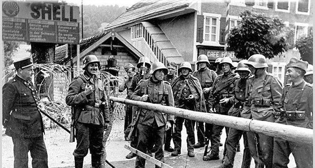 Swiss soldiers (R) with French policeman and German soldier along Franco-Swiss border during World War II. Switzerland mobilized 800,000 troops during this war, roughly 20 per cent of the country's four million people.