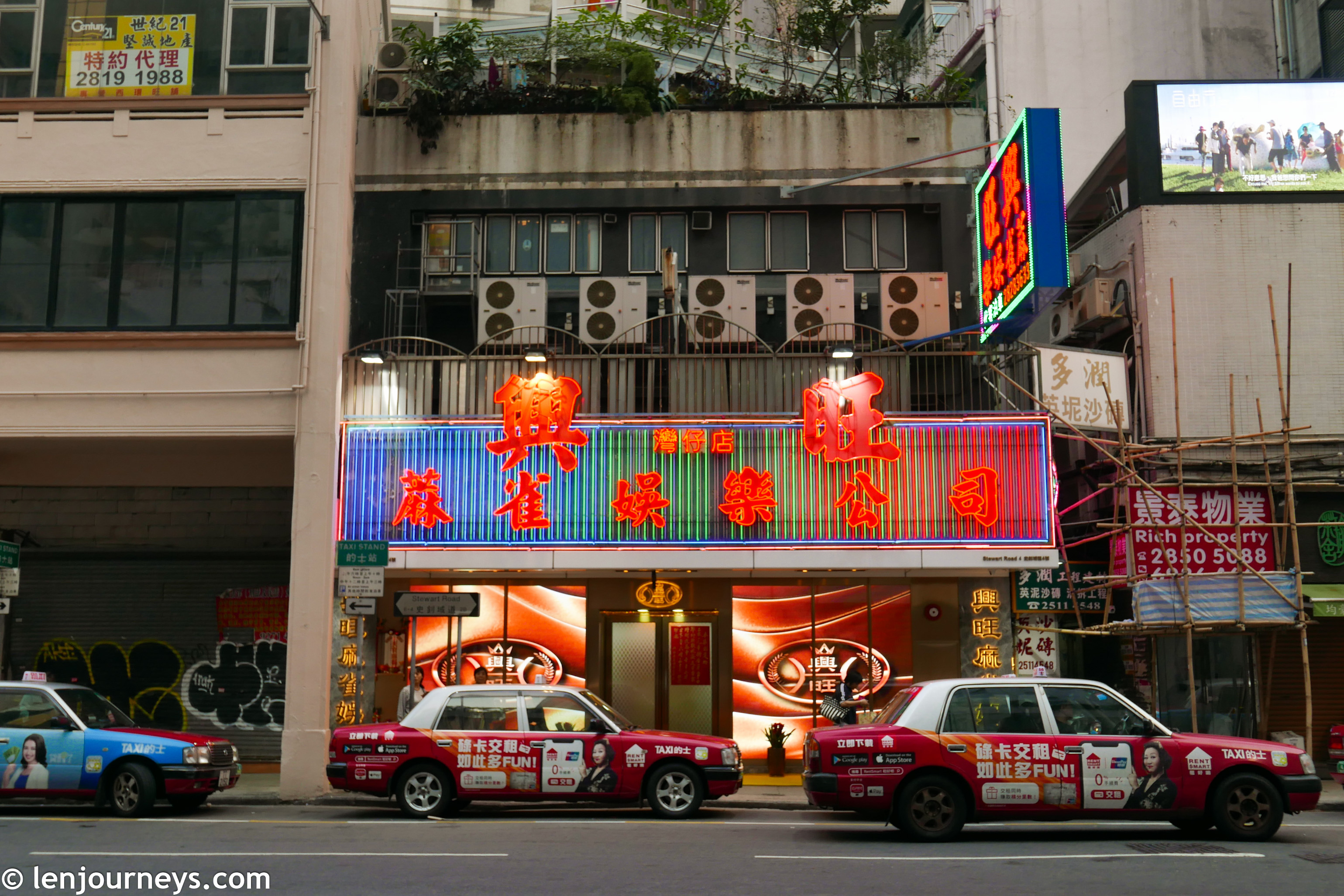 Taxi packing in front of a building in Hong Kong