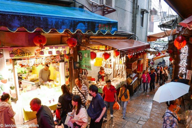 The main street of Jiufen packed with food stalls and tourists