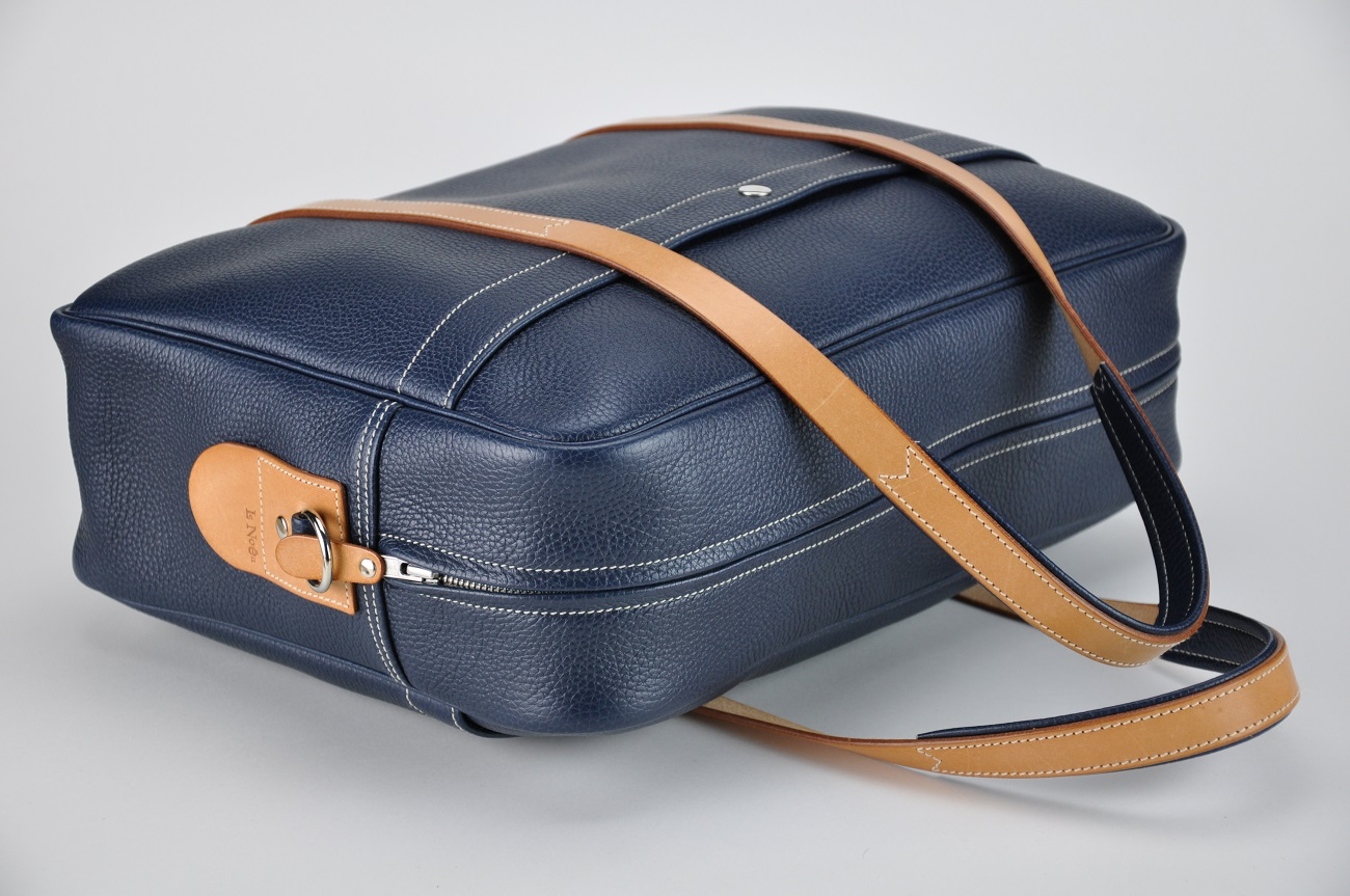 Weekend or business bag in grained blue cowhide, for man or woman. Made in France. Luxury fashion accessories.