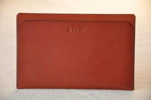 Paper holder, passport case in orange calfskin. Luxury leather goods made in France.