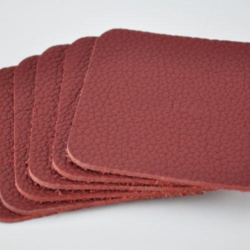 Dessous de verre en taurillon rouge. Fabrication française.